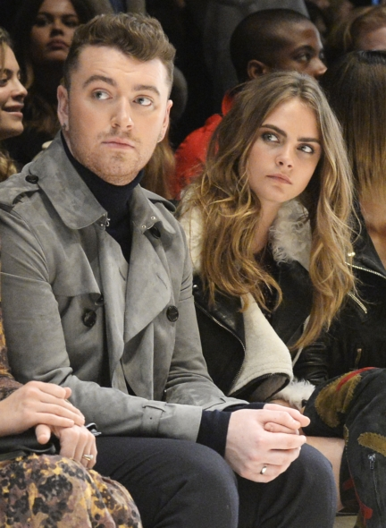 sam-smith-and-cara-delevingne-wearing-burberry-at-the-burberry-womenswear-autumn_winter-2015-show