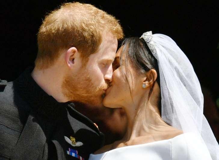 Prince Harry & Meghan Markle Kiss Following Wedding