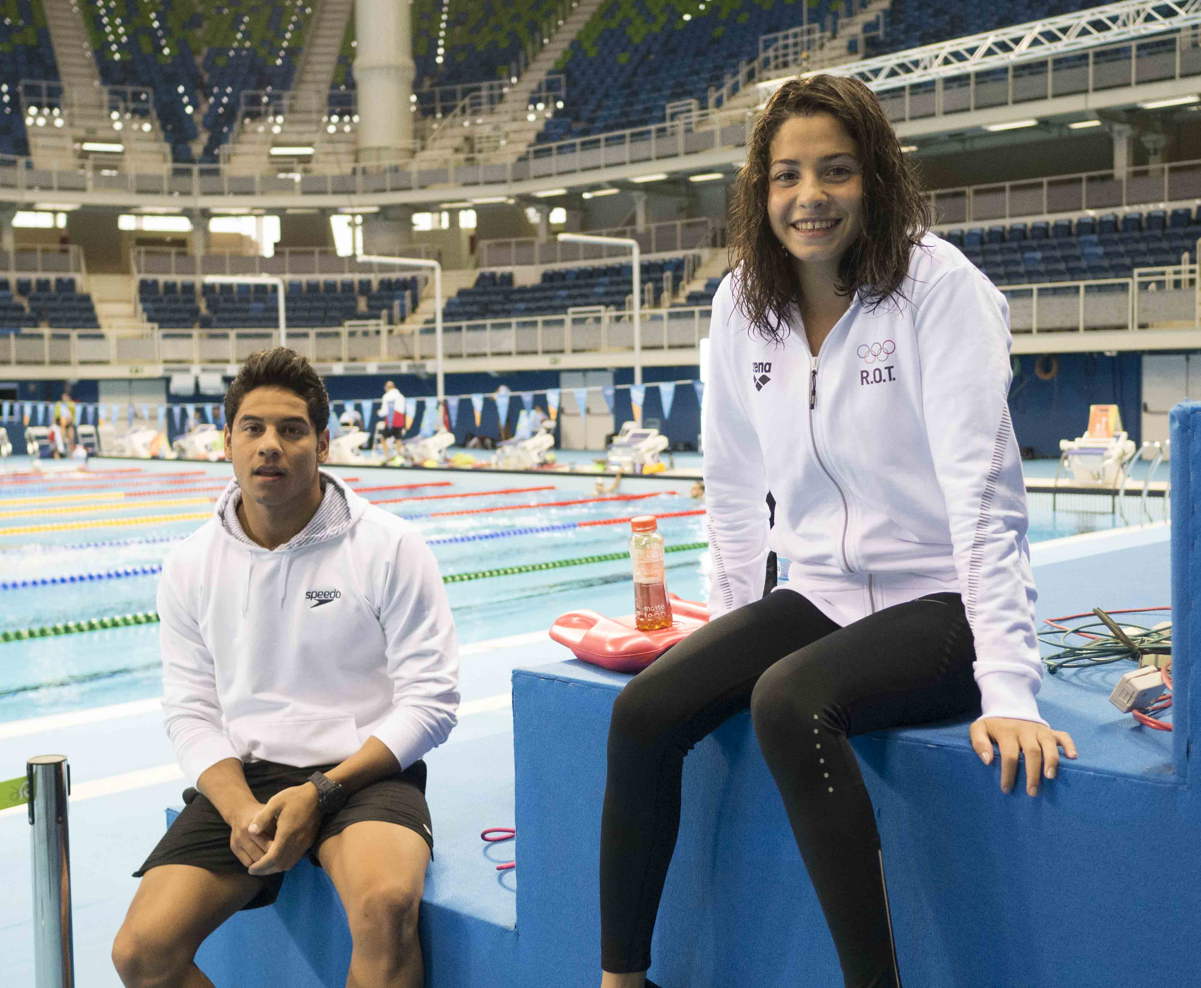 Refugee Team Swimmers:Rami Anis & Yusra Mardini at training poolstretching and swimming lapsRami Coach: Carine VerbauenYusra Coach: Sven Spannekrebsvisiting the Competition Pool after practice