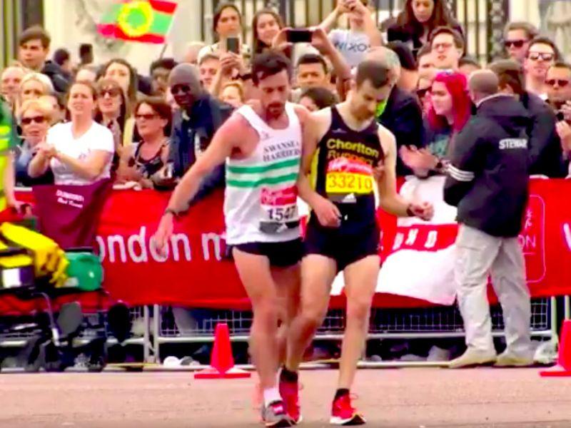 Matthew Rees Helps Exhausted Runner David Wyett Over Line