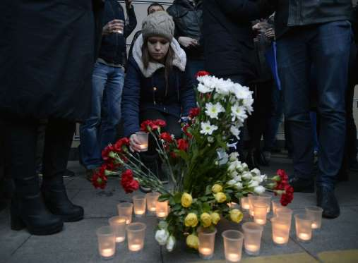 People Light Candles In Vigil For Russian Metro Blast Victims